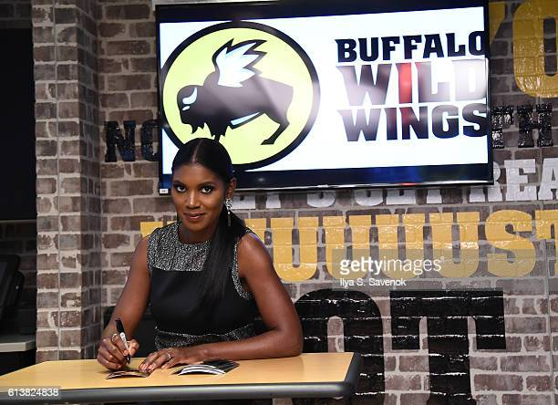 Actress Actress Denise Boutte signs autographs at Buffalo Wild Wings Times Square on October 10 2016 in New York City
