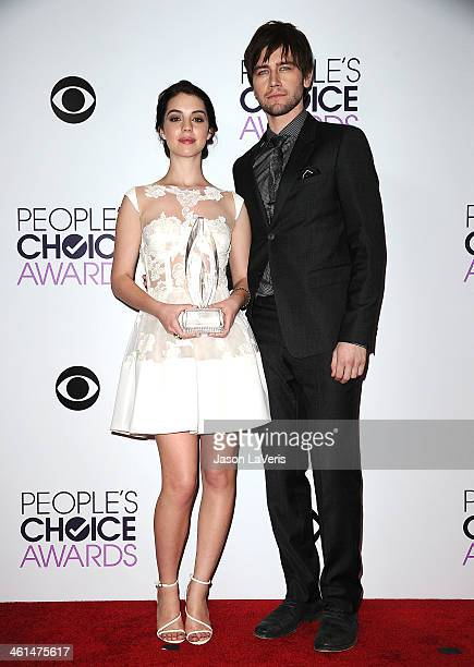 Actress Adelaide Kane and actor Torrance Coombs pose in the press room at the 40th annual People's Choice Awards at Nokia Theatre LA Live on January...