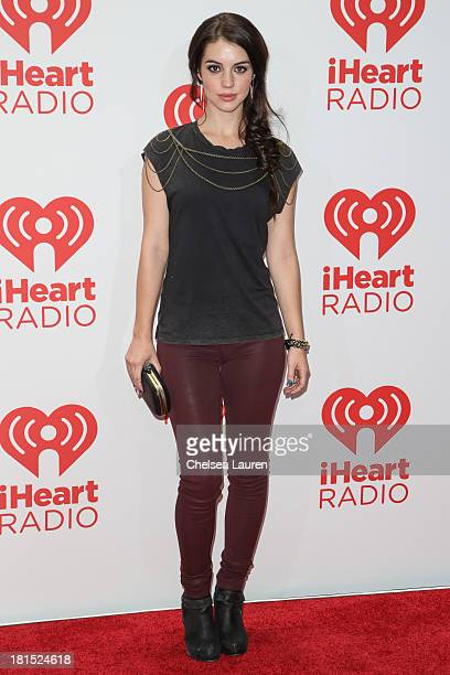 Actress Adelaide Kane poses in the iHeartRadio music festival photo room on September 21 2013 in Las Vegas Nevada