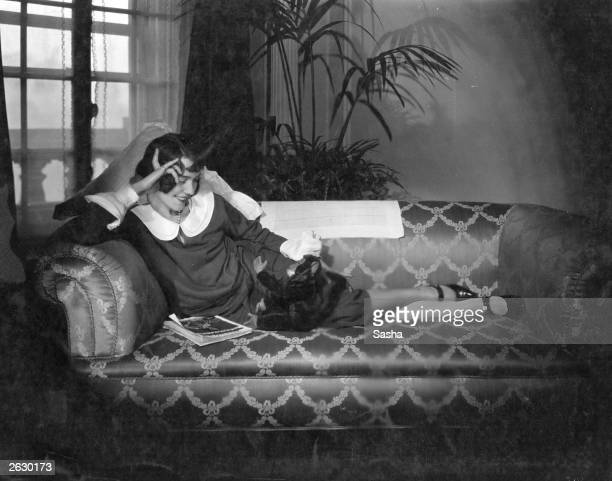 Actress Adele Astaire relaxing with her toy monkey Original Publication People Disc HS0046