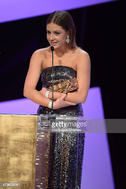 Actress Adele Exarchopoulos accepts the Most Promising Actress award for 'Blue Is the Warmest Color' on stage during the 39th Cesar Film Awards 2014...