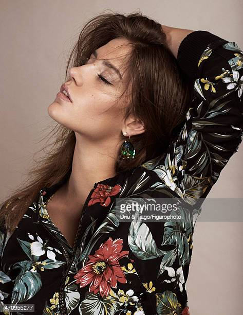 108177004 Actress Adele Exarchopoulos is photographed for Madame Figaro on December 18 2013 in Paris France Jacket earring Makeup by Dior PUBLISHED...