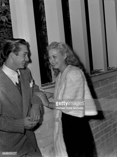 Actress Adele Mara with a friend smile on a street in Los Angeles California