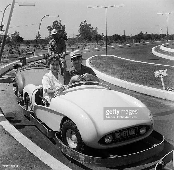 Actress Adelle August poses as she rides on Autopia during the Opening day of Disneyland in AnaheimCalifornia