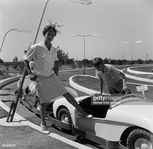 Actress Adelle August poses as she steps in the Autopia ride during the Opening day of Disneyland in AnaheimCalifornia
