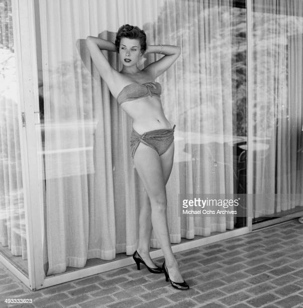 Actress Adelle August poses by the pool in Los Angeles California