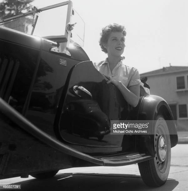 Actress Adelle August poses in a car in Los Angeles California