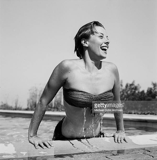 Actress Adelle August poses in the pool in Los Angeles California
