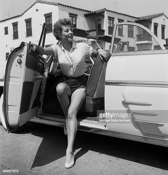 Actress Adelle August poses with a car in Los Angeles California