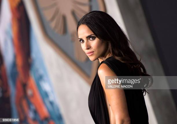 TOPSHOT Actress Adria Arjona attends The Universal Premiere 'Pacific Rim Uprising at the Chinese Theater on March 21 in Hollywood California / AFP...
