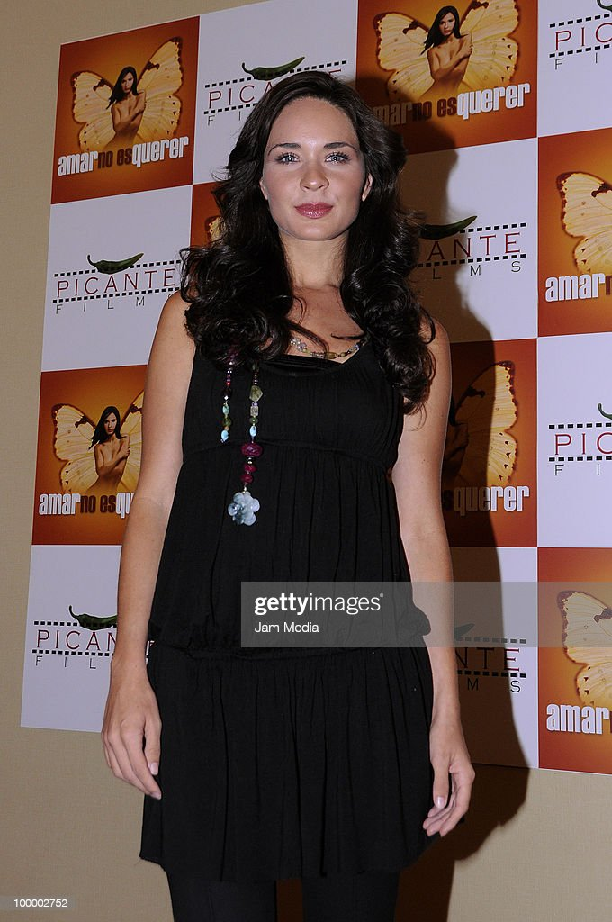 Actress Adriana Louvier poses for a photograph during a press conference to present the movie 'Amar no es Querer' at Marriot Hotel on May 19, 2010 in Mexico City, Mexico.