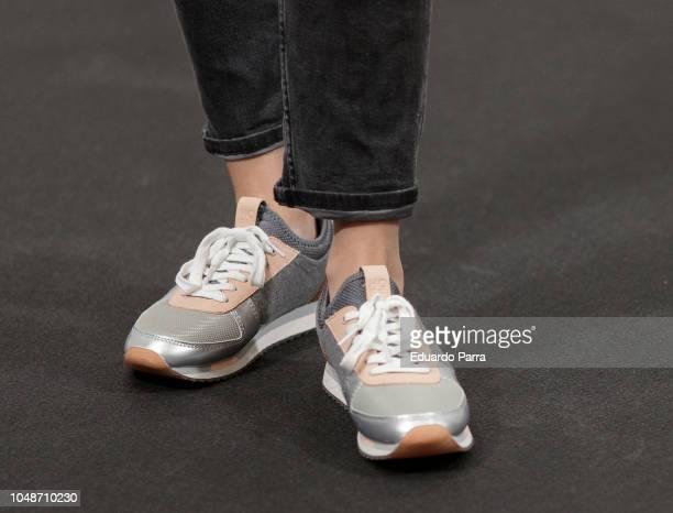 Actress Adriana Torrebejano sneakers detail attends the 'La sombra de la ley' photocall at Palacio de los duques hotel on October 10 2018 in Madrid...