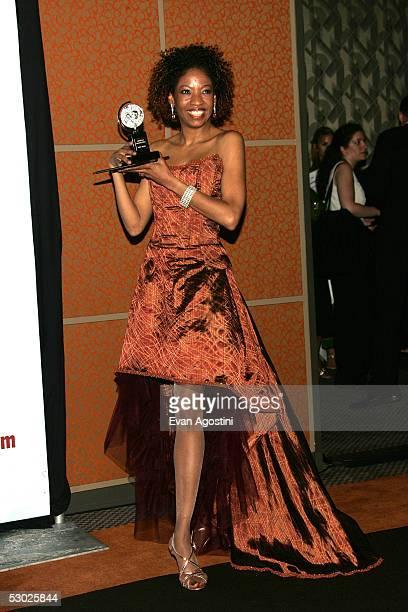 Actress Adriane Lenox poses with the award for Best Performance By A Featured Actress In A Play for 'Doubt' in the press room at the 59th Annual Tony...