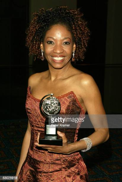 Actress Adriane Lenox poses with the award for Best Performance By A Featured Actress In A Play for the play 'Doubt' at the after party for the 59th...