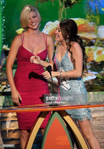 Actress Adrianna Palicki presents the 'Choice TV Actress Comedy' award for 'Hannah Montana' to actress Miley Cyrus onstage during the 2007 Teen...