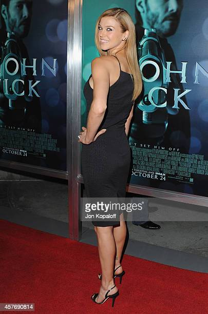 Actress Adrianne Palicki arrives at the Los Angeles special screening John Wick at ArcLight Hollywood on October 22 2014 in Hollywood California