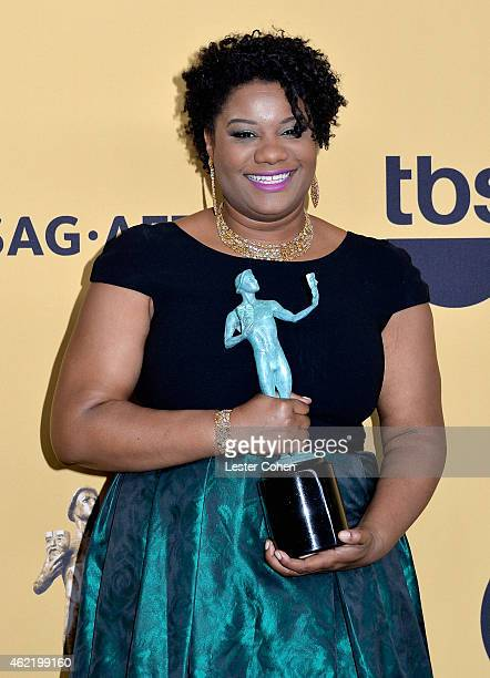 Actress Adrienne C Moore poses in the press room at the 21st Annual Screen Actors Guild Awards at The Shrine Auditorium on January 25 2015 in Los...