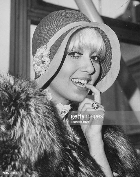Actress Adrienne Posta pictured preparing to fly to Los Angeles to start work in the television show 'Lampoon' at London Airport May 1st 1974
