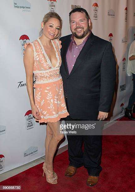 Actress Aexandra Holden and actor/writer MJ Dougherty attend the launch party for MJ Dougherty's 'Life Lessons from a Total Failure' at The Sandbox...