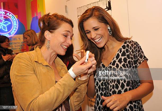 Actress Aglaia Szyszkowitz and Karen Webb attend the Kiehl's Store Opening on November 24 2010 in Munich Germany