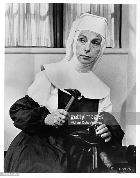 Actress Agnes Moorehead fixes a shoe in a scene the movie 'The Singing Nun ' circa 1966