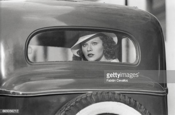 Actress Agostina Belli rides in a car during a scene from the 1976 Italian film Telefoni Bianchi The movie written and directed by filmmaker Dino...