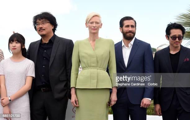 Actress Ahn SeoHyun Director Bong JoonHo actors Tilda Swinton Jake Gyllenhaal and Steven Yeun attend the 'Okja' photocall during the 70th annual...