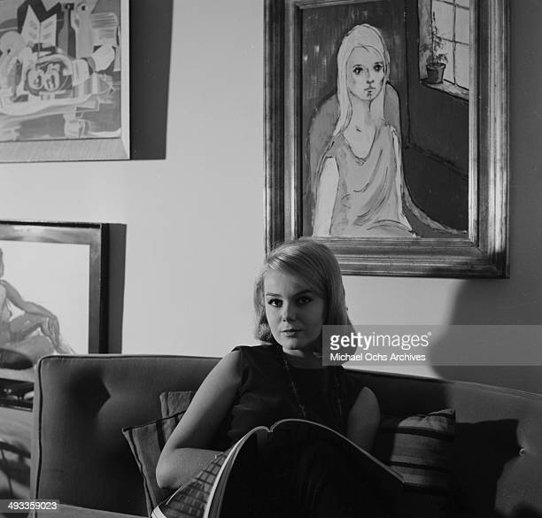 Actress Ahna Capri poses at home in Los Angeles California