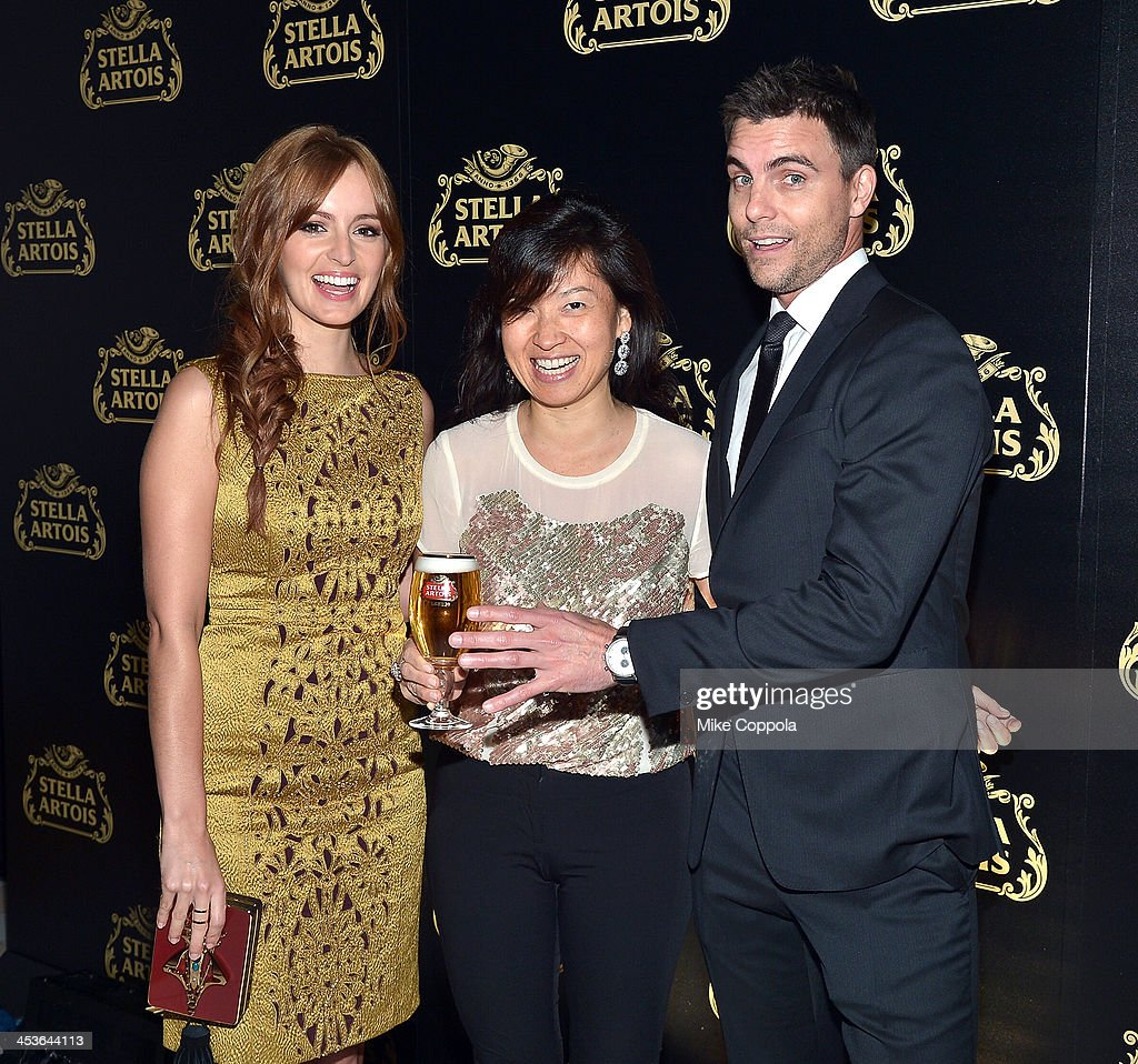 Actress Ahna O'Reilly, Global Vice President of Stella Artois Debora Koyama, and Actor Colin Egglesfield at launch event for Stella Artois Crystal Chalice in New York Citys Meatpacking District on December 4, 2013.