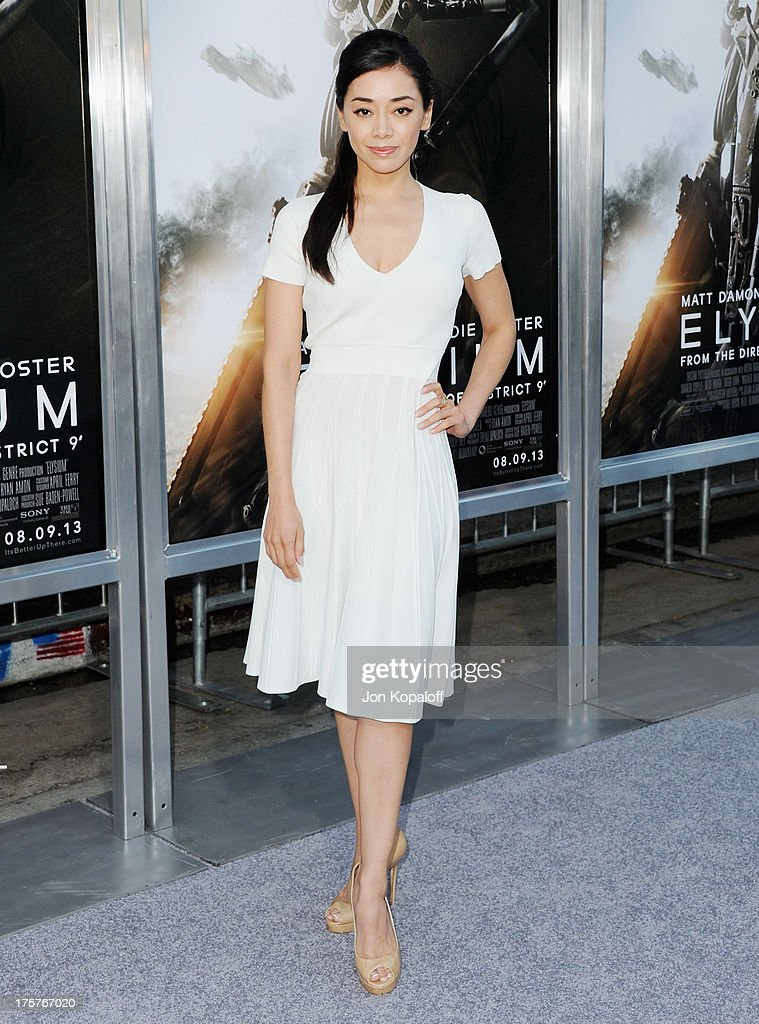 Actress Aimee Garcia arrives at the Los Angeles Premiere 'Elysium' at Regency Village Theatre on August 7, 2013 in Westwood, California.