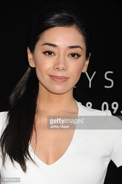 Actress Aimee Garcia arrives at the Los Angeles premiere of 'Elysium' at Regency Village Theatre on August 7 2013 in Westwood California