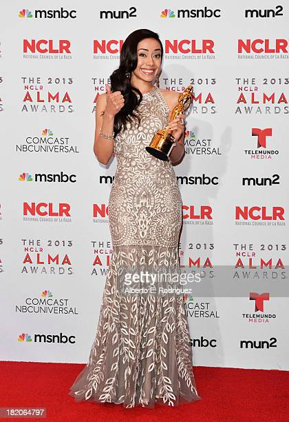 Actress Aimee Garcia poses with the Year in Television Award for 'Dexter' at the Winner's Walk during the 2013 NCLR ALMA Awards at Pasadena Civic...
