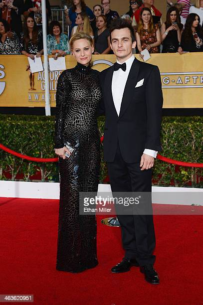 Actress Aimee Mullins and actor Rupert Friend attend the 20th Annual Screen Actors Guild Awards at The Shrine Auditorium on January 18 2014 in Los...