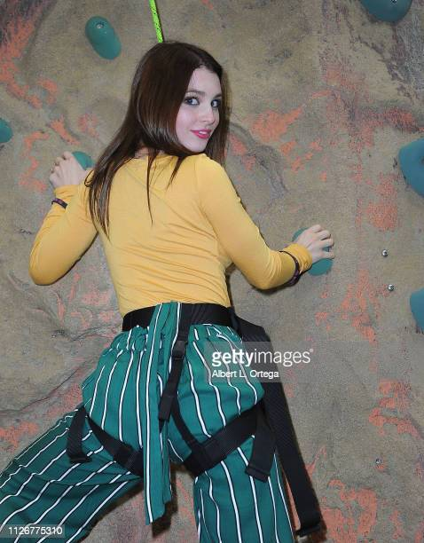 Actress Ainsley Ross climbs the rockwall at The 2019 Abilities Expo held at Los Angeles Convention Center on February 22 2019 in Los Angeles...