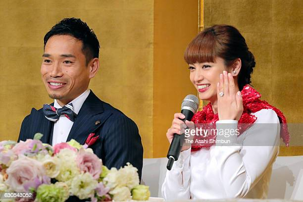 Actress Airi Taira shows her engagement ring presented by football player Yuto Nagatomo during a press conference announcing their engagement on...