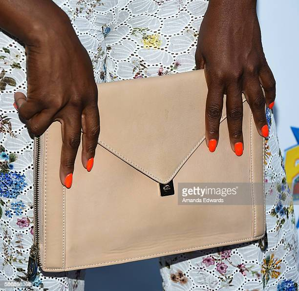 Actress Aisha Hinds clutch and manicure detail arrives at the Cocktails For A Cause event benefiting Kids In The Spotlight on August 6 2016 in Los...