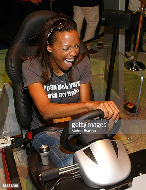 Actress Aisha Tyler plays Forza Motorsport 3 at the Xbox Booth during E3 at the Los Angeles Convention Center on June 2, 2009 in Los Angeles,...