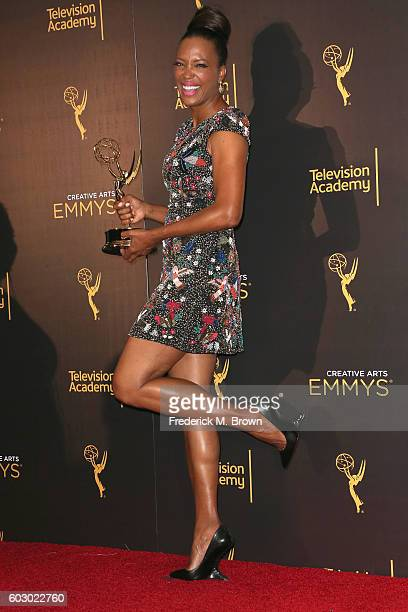 Actress Aisha Tyler winner of Outstanding Animated Program poses in the press room during the 2016 Creative Arts Emmy Awards at Microsoft Theater on...