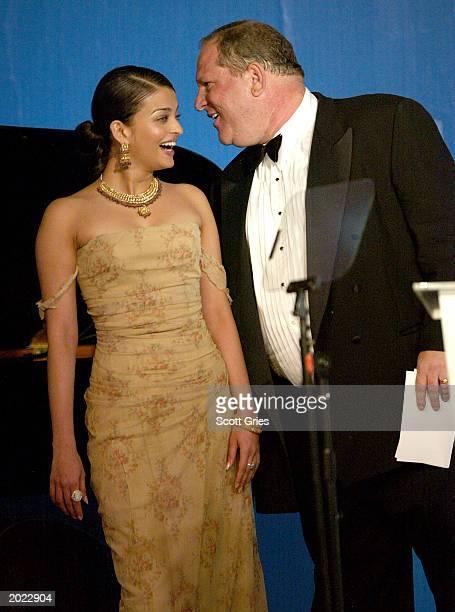 Actress Aishawarya Rai and Head of Miramax Films Harvey Weinstein attend amfAR's Cinema Against AIDS benefit during the 56th International Cannes...