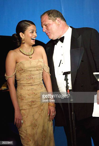 Actress Aishawarya Rai and Head of Miramax Films Harvey Weinstein attend amfAR's 'Cinema Against AIDS' benefit during the 56th International Cannes...