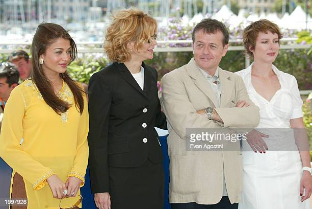 Actress Aishwarya Rai actress Meg Ryan director Patrice Chereau and actress Karen Viard pose during a photocall for the members of the 2003 Cannes...