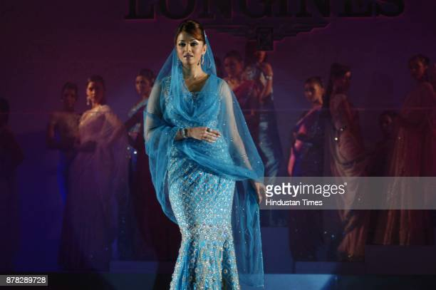 Actress Aishwarya Rai Bachchan walks on the ramp during the launch of bridal collection of Longines watches in New Delhi on Wednesday