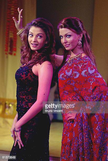 """Actress Aishwarya Rai poses at the """"Bollywood 4 Beginners"""" photocall at Madame Tussauds on September 30, 2004 in London."""