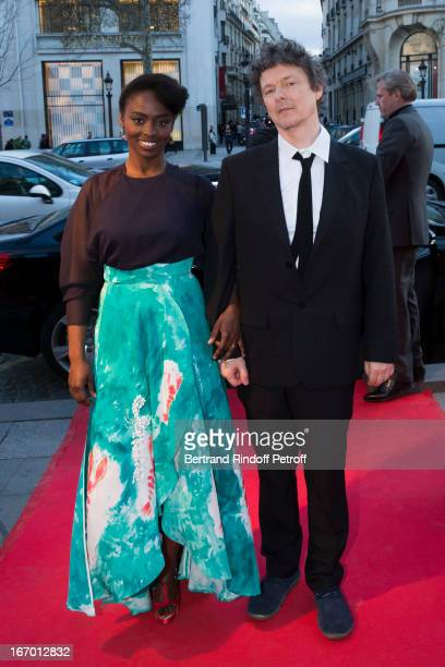 Actress Aissa Maiga and director Michel Gondry arrive for the premiere of Gondry's film 'L'Ecume Des Jours' at Cinema UGC Normandie on April 19 2013...