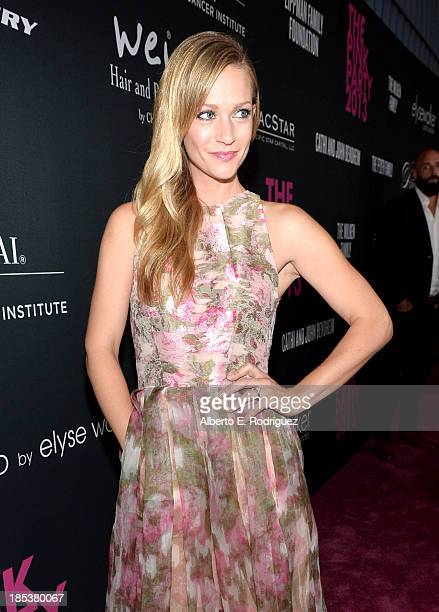 Actress AJ Cook attends Elyse Walker Presents The Pink Party 2013 hosted by Anne Hathaway at Barker Hangar on October 19 2013 in Santa Monica...
