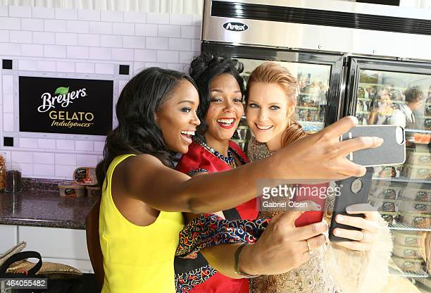 Actress Aja Naomi King Producer Kiara C Jones and actress Darby Stanchfield take a selfie while stopping by the Breyers Gelato Indulgences Lounge...