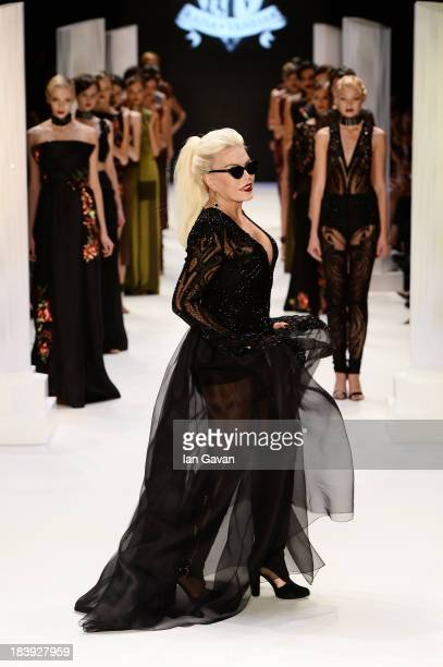 Actress Ajda Pekkan walks the runway at the RaisaVanessa Sason show during MercedesBenz Fashion Week Istanbul s/s 2014 Presented By American Express...