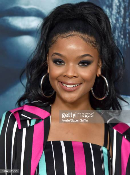 Actress Ajiona Alexus arrives at Universal Pictures' special screening of 'Breaking In' at ArcLight Cinemas on May 1 2018 in Hollywood California