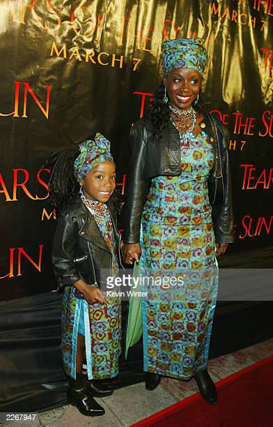 Actress Akosua Busia and her daughter Hadar Singleton pose at the premiere of Tears of the Sun at the Village Theater on March 3 2003 in Los Angeles...