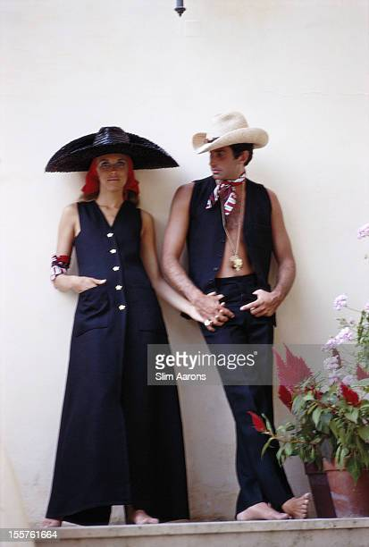 US actress Alana Collins and US actor George Hamilton pose wearing hats on the island of Capri Italy in September 1968 Collins and Hamilton married...